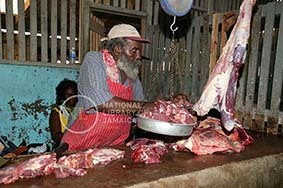 d_0004364_meat_vendor_annotto_bay_market.JPG