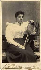 http://nlj.gov.jm/Digital-Images/d_0001938_lady_sitting_tennis_racket.jpg