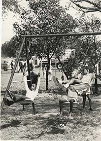 d_0005066_playing_outdoors_on_swing.jpg