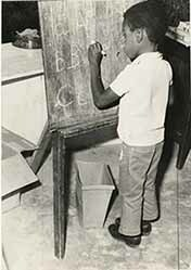 d_0005439_boy_writing_chalkboard.jpg