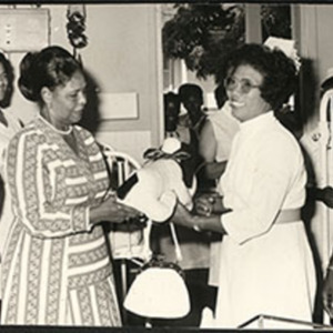 d_0007474_nurse_collecting_donated_item.jpg