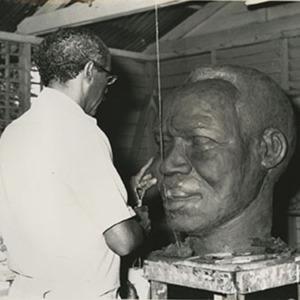 d_0007552_carifesta_1976_sculptor_working_away.jpg