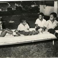 d_0004606_children_enjoy_goodies_mona_rehab_centre.jpg