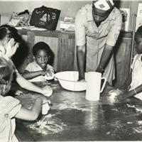 d_0004545_children_learning_to_knead_flour.jpg