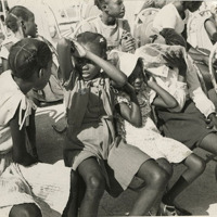 d_0004608_children_sitting_shading_from_hot_sun.jpg